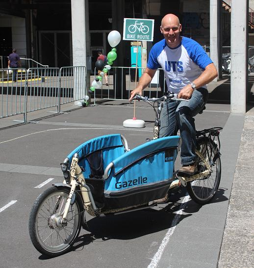 Andrew Redgrave from UTS Housing trying out a cargo bike prior to purchasing new bikes for the residents